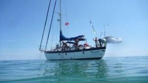 Sailboat at anchor in a calm sea